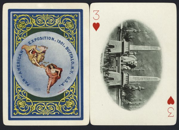 """Souvenir playing card out of a full deck from the Pan-American Exposition. The Three of Hearts displays a drawing of the """"Beautiful Orient."""" Two obelisks frame the head of the Sphinx with a stone wall surrounding the area. Other towers and palm trees fill the background. In the foreground is a crowd of people with donkeys and camels. On the reverse is the official logo for the Pan-American Exposition in full color, with an ornate border."""