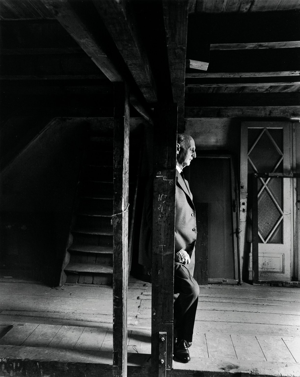 Otto Frank in the attic of the Secret Annex, a few hours before the official opening of the Anne Frank House on 3 May 1960.