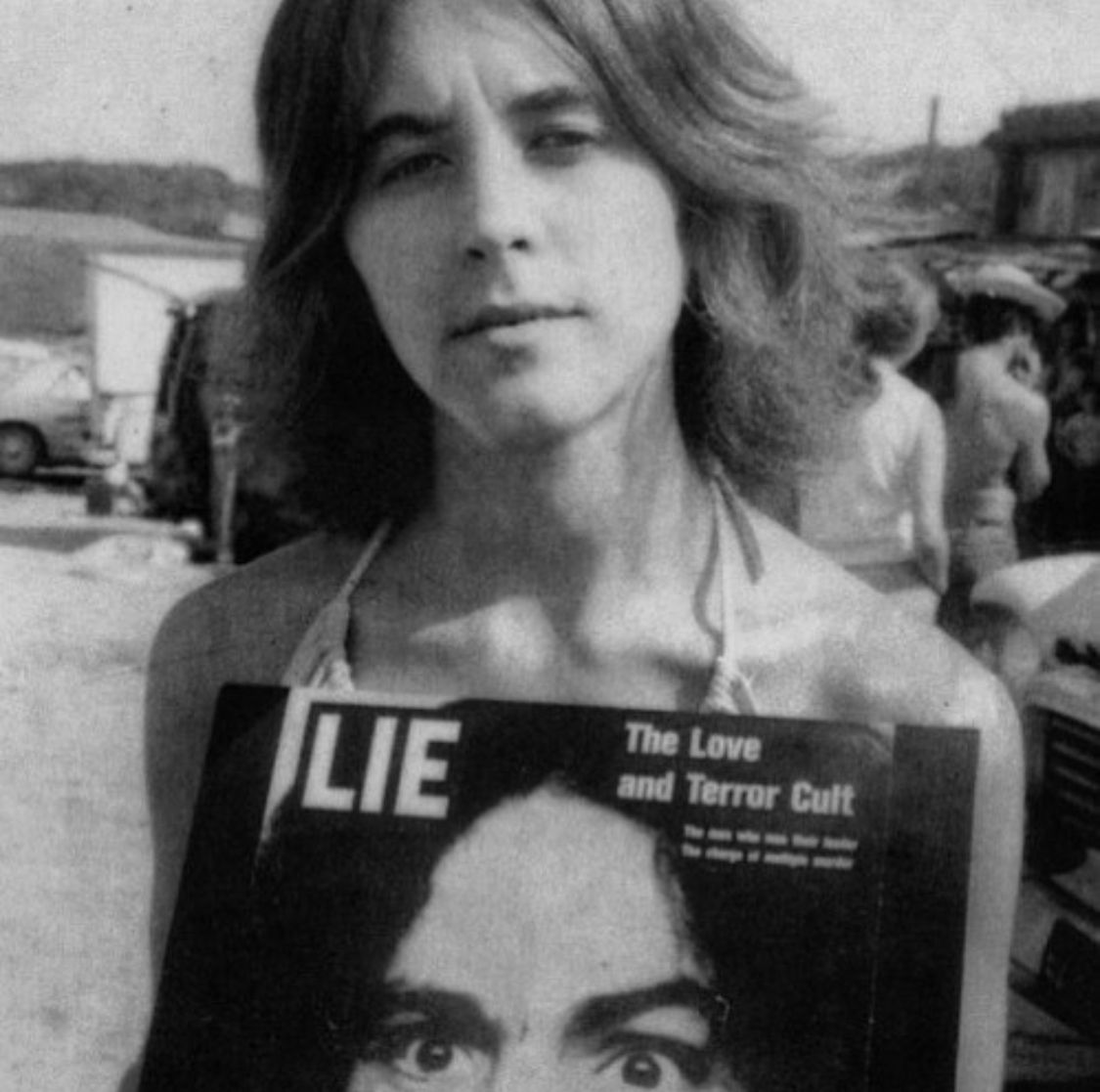 Ruth Ann Moorehouse holding Charlie's first record, LIE | Charles manson family, Manson family, Charles manson